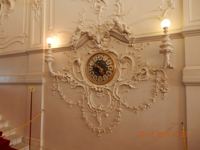 Clock on the wall in the Hermitage Museum