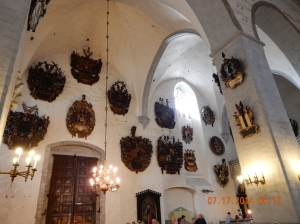 Coats of armor from the Aristocrats.  The most prominent place in the church, was from the wealthiest family.