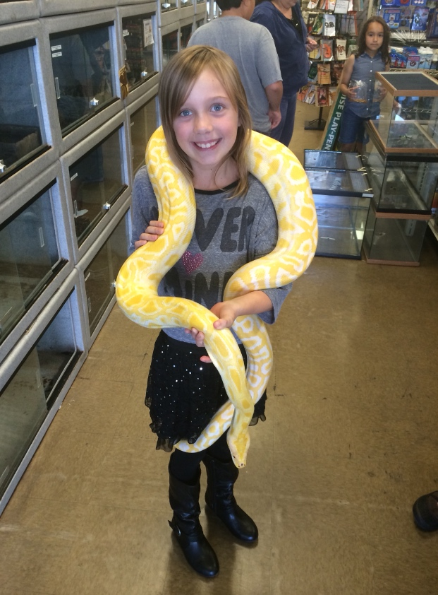 Sage holding Ellsa the albino python.