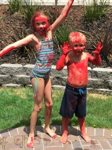 Sage & Nolan playing in red paint! Summer 2015