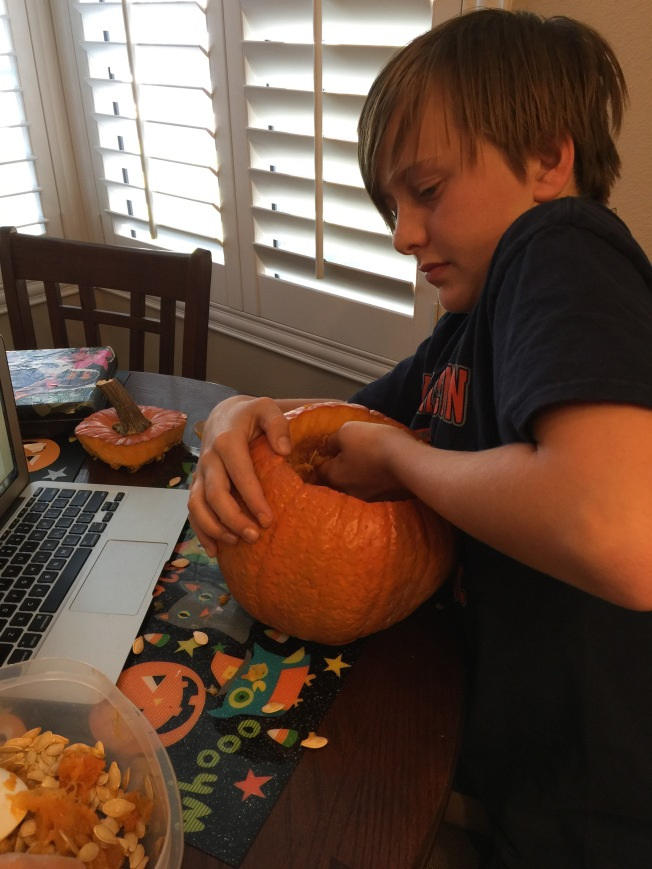 Connor working on his pumpkin